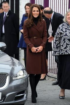Kate Middleton Wool Coat Kate Middleton looked demure as ever in a burgundy wool coat with a thin leather belt.