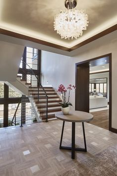 The foyer has the home's centerpiece: a stairway backed by a wall of windows.