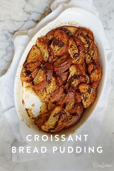 Croissant Bread Pudding. Pastries are awesome. But pastries go stale very quickly. So what are you supposed to do with all those leftover, say, croissants you thought your family would house while in town for the holidays? Make croissant bread pudding covered in chocolate sauce, of course.