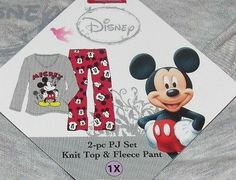This two piece Mickey Mouse Pajama Set comes tied up in a red ribbon ready for gift giving.  Knit top is gray and features Disney's Mickey Mouse. Has the words Mickey in red glittery letters.  Fleece pants are red and feature Mickey Mouse heads.  Size 1X  New with tags