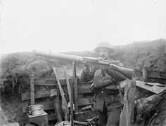 MINISTRY INFORMATION FIRST WORLD WAR OFFICIAL COLLECTION (Q 10738)   A Lewis Gunner of the 1/7th King's Liverpool Regiment cleaning his gun in the line at Givenchy. 15 March 1918. (55th Division).