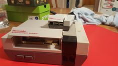 My original NEW next to the raspberry pi NES MY BEST friend gave me for christmas