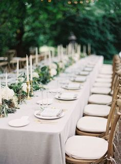 neutral outdoor tablescape with candles