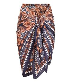 33f07daa0b925 Dark blue. Sarong in airy woven fabric with a printed pattern. Size 51 x
