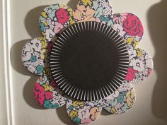This is a chipboard flower from Michaels. The center is paper from Target.
