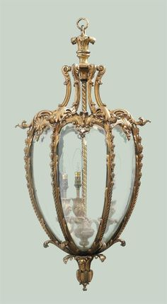 A GILT-BRONZE HALL LANTERN -  AFTER THE DESIGN BY THOMAS CHIPPENDALE, EARLY 20TH CENTURY