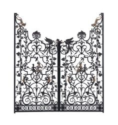 A PAIR OF AMERICAN SILVERED AND GILT-BRONZE-MOUNTED WROUGHT IRON GARDEN GATES BY EDWARD F. CALDWELL & CO., NEW YORK, CIRCA 1923