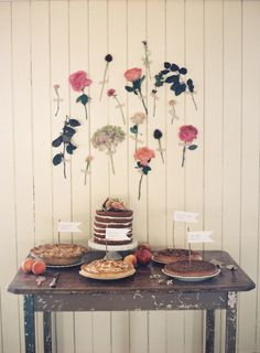 cake table and floral backdrop / Byron Loves Fawn Photography
