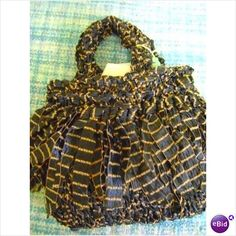Hand knitted small fringled handbag one of Cathys Unique Desidns