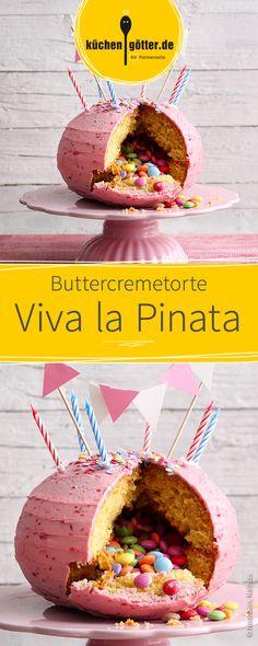 Kreative Buttercremetorte, gefüllt mit bunten Smarties oder anderen Süßigkeiten. Die Piñata-Torte eignet sich hervorragend für Kindergeburtstage.