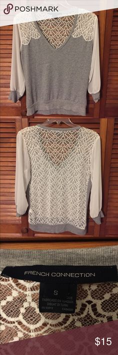Grey sweater with lace back and sheer arms size sm This French Connection shirt size small is super cute with the lace back. The arms are white sheer material. Looks great with slacks or jeans! French Connection Sweaters V-Necks