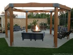 pergola with swing and fire pit   www.CypressMoonPorchSwings.com
