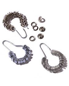 It's hard to keep track of small hardware such as washers, grommets, and nuts. Here's a handy way to organize them by size and type: String them on shower curtain rings. Hang the metal rings on a board above your workbench so the loose hardware will be even easier to spot.