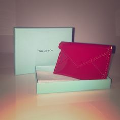 Tiffany & Co. Red Leather mini wallet Cute, glossy, fashionable, mini wallet/ card holder. Adds color to your life:) Tiffany & Co. Bags Wallets