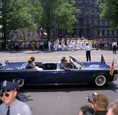 President John F. Kennedy and Mrs. Jackie Kennedy In route to greet Ivory Coast President Felix Houphouet-Boigny on his arrival to Washington D.C. May 22, 1962.