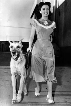 """Elizabeth Taylor goes for a walk with """"Duke"""", her pet in her next film. (AP-Photo) 1948"""