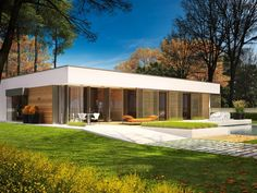 Dom zaprojektowany w duchu modernistycznego minimalizmu, koresponduje z najnowszymi trendami w architekturze. Chłodna biel tynku, proste, smukłe linie, a dla kontrastu – ciepłe, drewniane akcenty łączą się w harmonijną kompozycję elewacji.