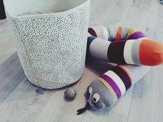 ferm LIVING Mint Dot Basket: http://www.fermliving.com/webshop/shop/bathroom/baskets/mint-dot-basket-medium.aspx  Mr. Snake: http://www.fermliving.com/webshop/shop/all-products/mr--snake-cushion.aspx  Panda Hook: http://www.fermliving.com/webshop/shop/all-products/panda-hook.aspx
