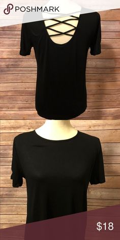 Cross Back Top 95% Rayon 5% Spandex This top features a round neck and 6a600a745