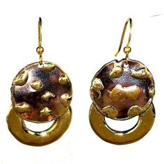 Handcrafted by South African artisans, these inch long brass earrings have a circle of polished brass tucked under a disk of darkend brass accented with polished brass droplets. The coloration is achieved using high heat rather than paints or dyes. Engraved Jewelry, Brass Jewelry, Jewelry Armoire, Jewellery, Polished Brass, Solid Brass, Handcrafted Jewelry, Earrings Handmade, Unique Earrings