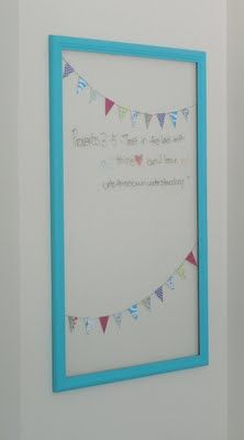 Glassboards. Take the whiteboard out of the frame and put glass in its place. Then write on the glass with a sharpie or dry erase (if you're wanting to change the wording once in awhile) and hang it up! Simple and so cute :)