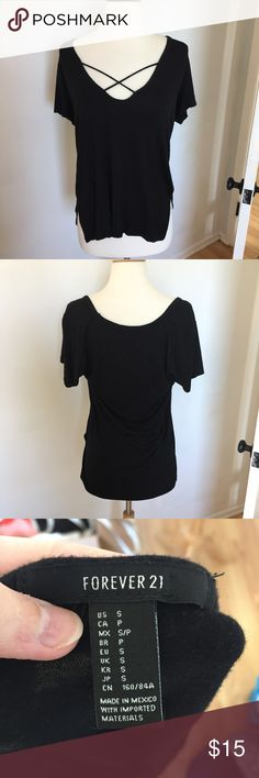Forever 21 Black Oversized Strappy Top A64 Trendy black top, gently worn with no flaws. Oversized, size small but will also fit a medium. Is a little low cut since it's loose fitting. Forever 21 Tops Tees - Short Sleeve