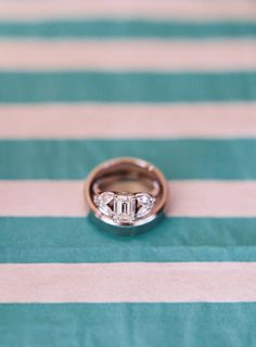 Emerald cut center and double marquise sides: http://www.stylemepretty.com/2015/05/16/23-vintage-inspired-engagement-rings/