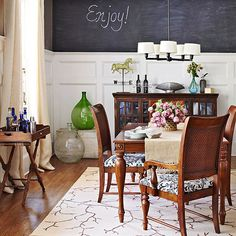 After years of gathering decor ideas, the homeowner decided it was time to infuse her home with some of her favorites. Here, using an idea she saw on a TV show, she covered the upper portion of the dining room walls with chalkboard paint. Not only did the walls become a focal point, but they can also serve as an easy-to-read menu board while entertaining. Warm wood floors and furniture warm up the black-and-white walls.