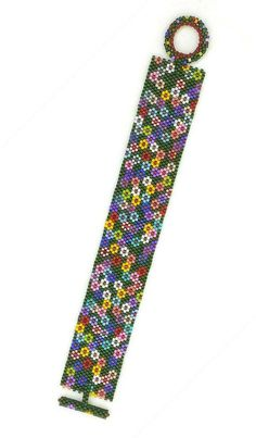 I just love all the colors in this Sue Arrighi design, Field of Flowers! This bracelet has a woven toggle and bar closure. This is just the piece to set of any summer wardrobe! Length: 7 inches = 17.8cm Width: 1 inch = 25mm If youd like this in another size and/or color scheme,