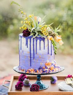 cosmic desert purple drip cake with gold flakes