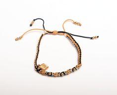 MM STBELT: Tejido en hilo de nylon con bolitas en chapa de oro y cristales checos corte diamante. Colores mostaza y negro