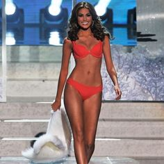 """And the winner of Miss Universe 2013 goes to… Gabriela Isler! The 25-year-old brunette . Something that makes us super proud? That seriously amazing bikini bod! Exercises every day and never skips her core work. """"I always work on my abs, every single day. Of course a good workout is never complete without a healthy diet, so we got the chance to dish with the personable pageant queen to find out what's on her typical (model) menu. Read on to find out!"""