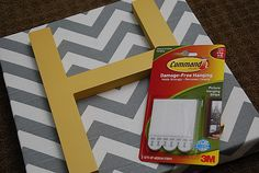 Yellow initial on gray-chevron fabric-covered canvas. Hmm...may have to do this for baby cooper!
