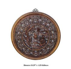 """This wall panel is made of solid elm wood and has dragon and phoenix pattern carving.   It is a unique oriental wall decoration for you living room or your business place.    Dimensions:   Diameter 31.25"""" x 1.25"""" thickness  Origin:             China  Material:          Solid Elm Wood"""