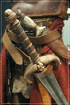 Conan The Barbarian Exhibition - London Film Museum : Jason Momoa's Conan The Barbarian Leather Battle Armour, his father's The Sword of Corin Sword & Dagger from Conan The Barbarian, via Flickr.