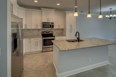 Transitional Kitchen with Chandelier, L-shaped, Crown molding, Pendant light, Kitchen island, Simple granite counters, Flush
