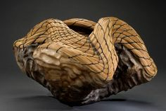 Valerie Seaberg Studios Work of the Heart  Hand built clay form, pit fired & woven with long leaf pine needles.