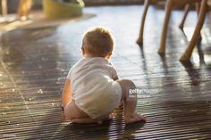 Stockfoto : Caucasian baby crawling on floor