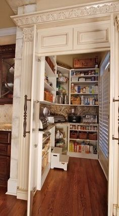 I would love to have a nice organized walk in pantry in my dream home.  In fact, I'd like two, one for foodstuffs and one for glasswear, dishes, pots & pans, small appliances, mixing bowls, various types of cake and bread pans and all the other cookery, bakery and drinkery impedimenta that regularly clutter up kitchen workspaces.