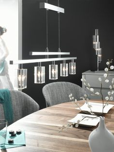 A 'rise and fall' pendant is very functional over a dining table.