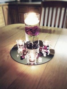 Single cylinder with votives centerpiece. Cylinder Vase Centerpieces, Mirror Centerpiece, Elegant Centerpieces, Purple Wedding Centerpieces, Floating Candle Centerpieces, Wedding Decorations, Silver Centerpiece, Vases, Rose Wedding