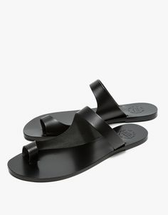 From ATP Atelier, a lightweight slip on sandal in Black. Features toe ring…
