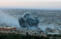 The Syrian conflict in photos - Smoke rises after Russian war crafts hit the Syrian rebel controlled town Daret Ezza in Aleppo, Syria on Oct. 13, 2015.
