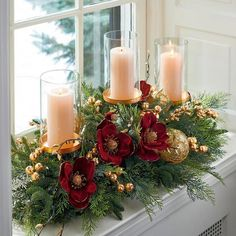 Realistic evergreen is brought to life with burgundy magnolias, gilded berries, sprigs of cypress, gold baubles and ornate ribbon. This candle holder embodies holiday elegance, bringing glamour to the home. Christmas Flower Arrangements, Christmas Table Centerpieces, Gold Christmas Decorations, Christmas Flowers, Christmas Candles, Floral Arrangements, Christmas Holidays, Christmas Wreaths, Candle Decorations