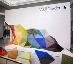 Wolf-Gordon, an American Design company that specializes in quality contract textiles and wallcoverings, showcased Office_Excavate, a custom made lounge area. Exhibition Stand Design, Exhibition Booth, Office Interior Design, Office Interiors, Office Designs, Retail Interior, Co Working, Environmental Design, Booth Design