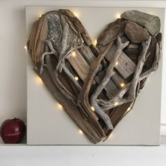 PLEASE ORDER BY TUESDAY EVENING, 9th FEBRUARY TO ENSURE DELIVERY FOR VALENTINE. Original driftwood heart with battery fairy lights mounted onto deep edge canvas.DUE TO THE NATURE OF EACH HEART BEING CREATED USING DRIFTWOOD, EACH ONE WILL BE UNIQUE IN ITSELF. IF YOU WOULD LIKE TO SEE THE EXACT HEART YOU'D BE PURCHASING, PLEASE CLICK ON 'ASK SELLER A QUESTION' AND I WILL SEND YOU IMAGES TO APPROVE.A perfect original gift for your loved one, to commemorate an Anniversary, Valentine, ...