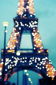 the eiffel tower sparkles every hour at night