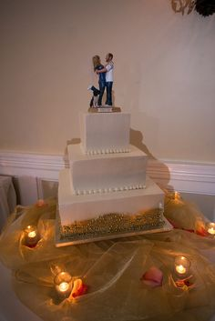 A clean simple 3 layer square wedding cake with a fun football fan topper. View more  NJ NYC wedding  photography and videography by Blue Moon Video Productions  http://www.bluemoonvideoproductions.com #bluemoonvideo