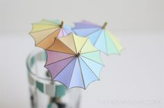 DIY drink umbrellas. Instead of the coloured panels, try making the umbrellas with your Instagram pictures!