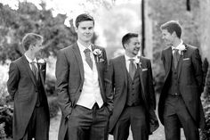 Groomsmen posing for photos outside of Braxted Park